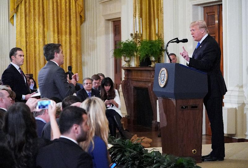 US President Donald Trump gets into a heated exchange with CNN chief White House correspondent Jim Acosta during a post-election press conference in the White House, an exchange that led to Acosta's ban by the administration (AFP Photo/MANDEL NGAN)