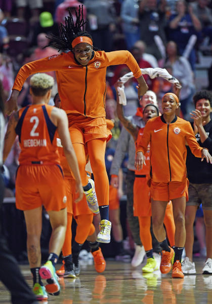 Connecticut Sun center Jonquel Jones races onto the court to celebrate with Natisha Hiedeman (2) after the Sun defeated the Dallas Wings in a WNBA basketball game Wednesday, Sept. 4, 2019, in Uncasville, Conn. (Sean D. Elliot/The Day via AP)