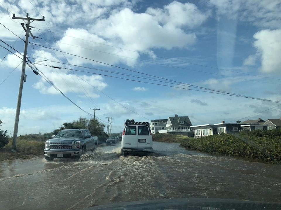 Surf Drive, a coastal road in Falmouth, Massachusetts, is flooded on Oct. 17, 2019.