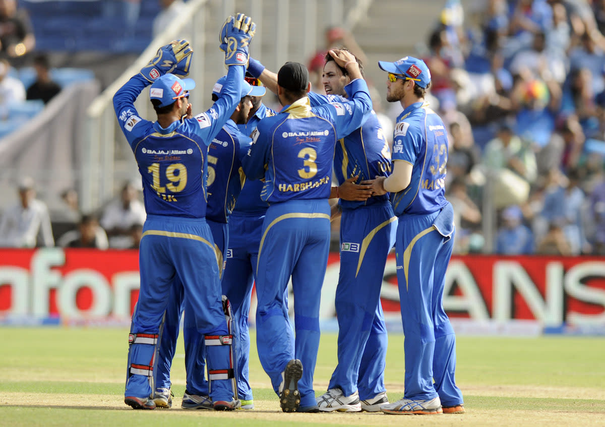Mitchell Johnson of Mumbai Indians celebrates the wicket of Aaron Finch captain of Pune Warriors during match 58 of the Pepsi Indian Premier League ( IPL) 2013  between The Pune Warriors India and the Kolkata Knight Riders held at the Subrata Roy Sahara Stadium, Pune on the 11th May 2013. (BCCI)