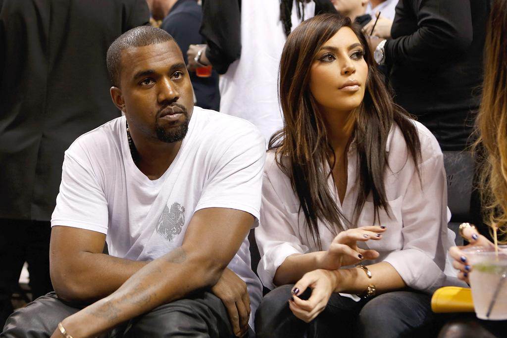 MIAMI, FL - DECEMBER 06:  Recording Artist Kanye West and television reality star Kim Kardashian attend a basketball game between the New York Knicks and Miami Heat at American Airlines Arena on December 6, 2012 in Miami, Florida. NOTE TO USER: User expressly acknowledges and agrees that, by downloading and or using this photograph, User is consenting to the terms and conditions of the Getty Images License Agreement.   (Photo by Christopher Trotman/Getty Images)