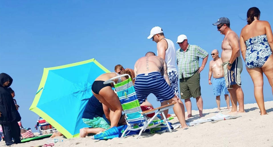 Bolt cutters were used to free the 67-year-old woman from the beach umbrella.