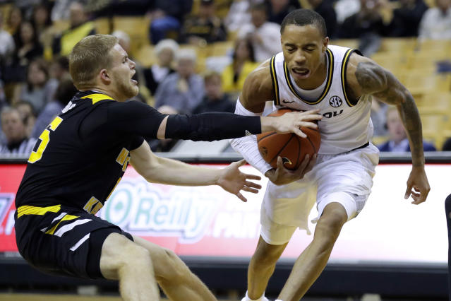 Missouri's Xavier Pinson, right, heads to the basket as Northern Kentucky's Tyler Sharpe, left, reaches for the ball during the second half of an NCAA college basketball game Friday, Nov. 8, 2019, in Columbia, Mo. Missouri won 71-56. (AP Photo/Jeff Roberson)