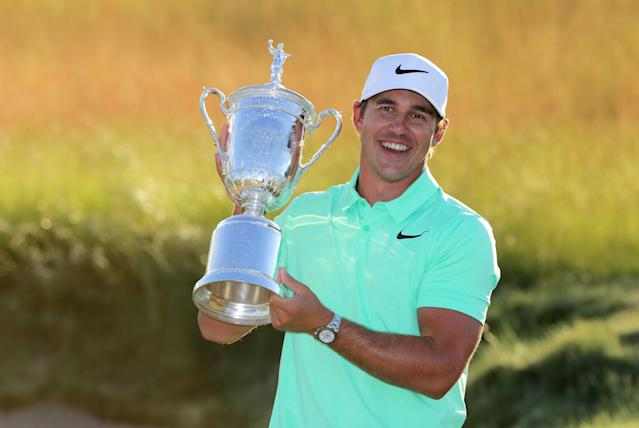 "<div class=""caption""> Brooks Koepka poses with the winner's trophy after his victory at the 2017 U.S. Open at Erin Hills. </div> <cite class=""credit"">Streeter Lecka/Getty Images</cite>"