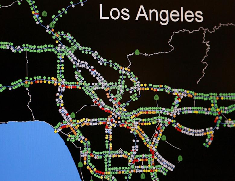 In this Friday, Oct. 18, 2013 photo, a regional map of traffic flow from sensors on Los Angeles County freeways is seen on a computer screen at the Los Angeles Regional Transportation Management Center in Los Angeles. Free-flowing traffic seen as green dots, with yellow and red dots indicating slowing to very slow traffic. The grey dots represent inoperative traffic sensors. About one-third of traffic sensors that Caltrans operates on highways statewide do not work. There are various reasons for this, including equipment failure, copper wire theft and construction projects that sever the systems locally. (AP Photo/Reed Saxon)