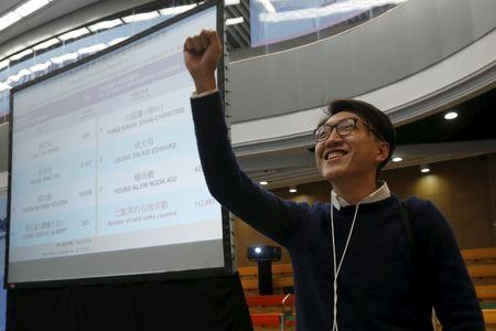 Edward Leung, a candidate from the Hong Kong Indigenous, acknowledges supporters during the vote counting of a Legislative Council by-election in Hong Kong, China February 29, 2016.   REUTERS/Bobby Yip