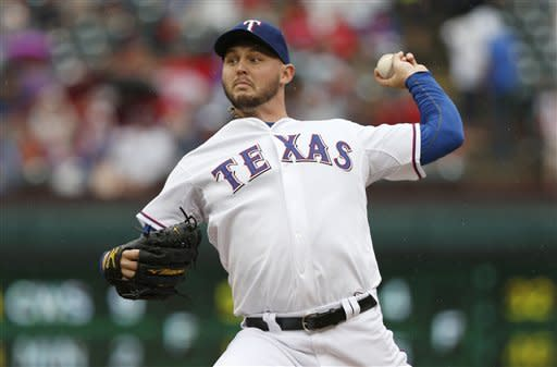 Texas Rangers starter Matt Harrison (54) throws to the Seattle Mariners in the first inning of a baseball game Sunday, Sep. 16, 2012, in Arlington, Texas. (AP Photo/Jim Cowsert)