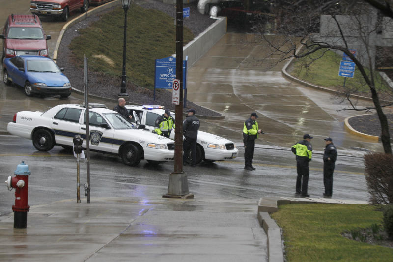 Police block the rear entrance to the Western Psychiatric Institute and Clinic on the University of Pittsburgh campus, Thursday, March 8, 2012 in Pittsburgh. There were reports of gunfire at the psychiatric clinic injuring several people, and police were looking for a gunman. (AP Photo/Keith Srakocic)