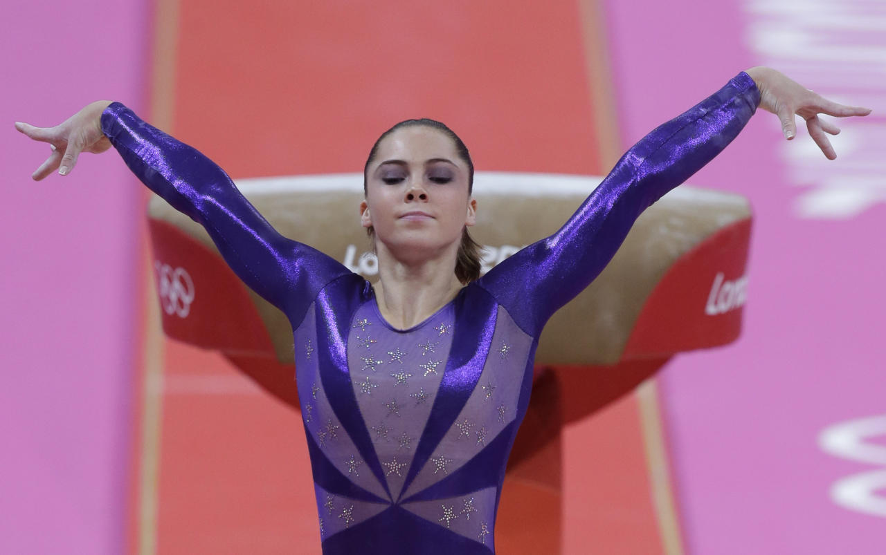 U.S. gymnast McKayla Maroney poses after completing her routine on the vault during the Artistic Gymnastic women's qualifications at the 2012 Summer Olympics, Sunday, July 29, 2012, in London. (AP Photo/Julie Jacobson)