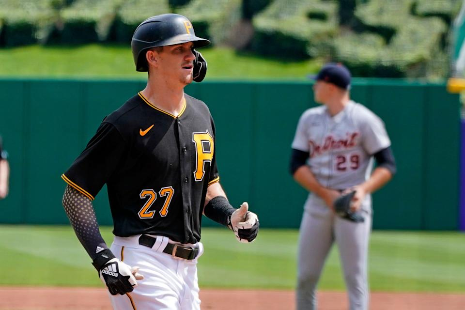Pittsburgh Pirates' Kevin Newman (27) runs home after hitting a two-run home run off Detroit Tigers starting pitcher Tarik Skubal (29) during the first inning of a baseball game in Pittsburgh, Monday, Sept. 6, 2021.