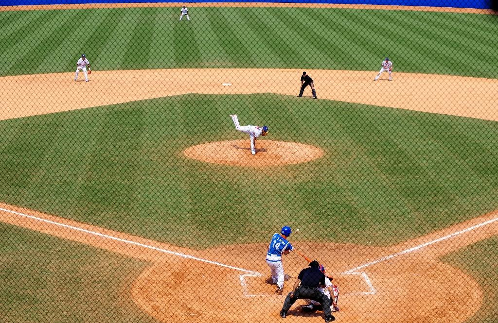 Taiwan faces South Korea in the men's preliminary round baseball game during the 2008 Beijing Olympics (AFP Photo/Frederic J. Brown)