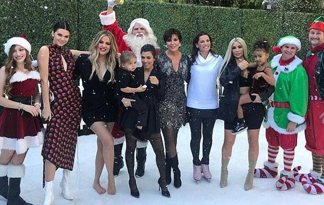 The Kardashian-Jenner family all gathered around for their Christmas special... but where's Kylie? Source: E!