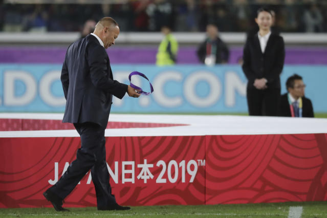 England coach Eddie Jones walks on the field after England was defeated by South Africa in the Rugby World Cup final at International Yokohama Stadium in Yokohama, Japan, Saturday, Nov. 2, 2019. (AP Photo/Eugene Hoshiko)