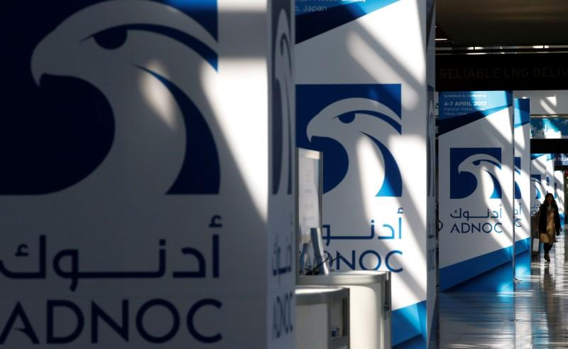FILE PHOTO: Logos of ADNOC are seen at Gastech, the world's biggest expo for the gas industry, in Chiba