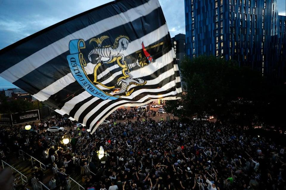Fans outside St James' Park last night after the deal was confirmed  (Action Images via Reuters)