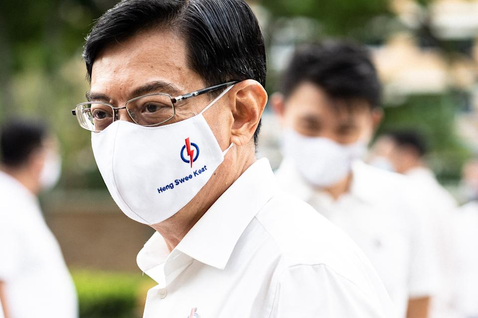 SINGAPORE - JULY 01: Candidate of Prime Ministry of Singapore Heng Swee Keat (4th L) meets residents seeking support as the state goes to the polls for general elections in Singapore on July 01, 2020. Officials wore face masks during the campaign as maintaining social distance as a precaution against coronavirus (Covid-19) pandemic. (Photo by Zakaria Zainal/Anadolu Agency via Getty Images)