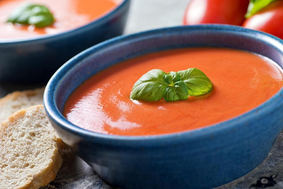 "<p>If you're amping up your grilled cheese, it's about time you amp up your tomato soup too — no more of that condensed canned stuff. This creamy tomato basil soup recipe uses aromatics to build flavor and heavy cream for a luxurious texture. Garnish with fresh basil for an extra herbaceous aroma and you're eating well.</p> <p><a href=""https://www.thedailymeal.com/best-recipes/tomato-basil-soup-freezer-homecooked-recipe?referrer=yahoo&category=beauty_food&include_utm=1&utm_medium=referral&utm_source=yahoo&utm_campaign=feed"" rel=""nofollow noopener"" target=""_blank"" data-ylk=""slk:For the Creamy Tomato Basil Soup recipe, click here."" class=""link rapid-noclick-resp"">For the Creamy Tomato Basil Soup recipe, click here.</a></p>"