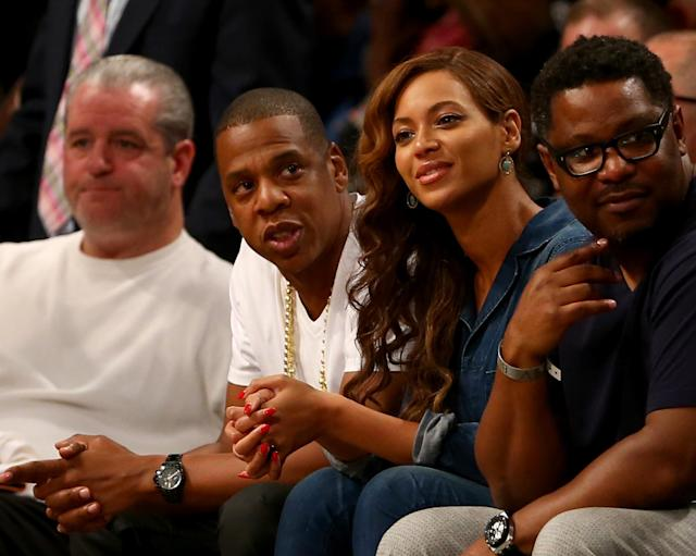 NEW YORK, NY - MAY 12: Jay-Z and Beyonce attend Game Four of the Eastern Conference Semifinals during the 2014 NBA Playoffs at the Barclays Center on May 12, 2014 in the Brooklyn borough of New York City. NOTE TO USER: User expressly acknowledges and agrees that, by downloading and/or using this photograph, user is consenting to the terms and conditions of the Getty Images License Agreement. (Photo by Elsa/Getty Images)