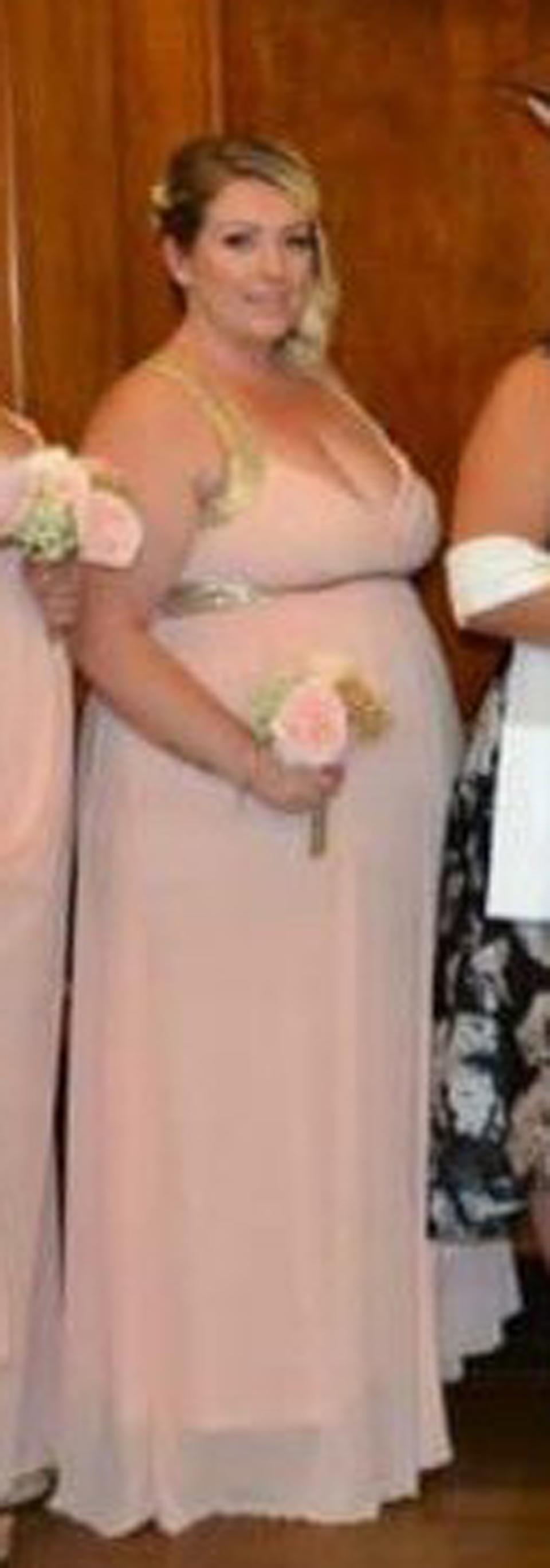 An obese bridesmaid has dropped six stone after a 'horrific' photo appeared online which made her look nine month pregnant. Ashleigh Bell, 32, says the photo changed her life and she suddenly realised that her size 24 waistline couldn't balloon any further. The mum-of-three spotted the photo on Facebook last July six months after her sister's wedding in 2018. Ashleigh says she felt 'mortified' by the awful image - which she says made her look pregnant - and actually apologised to her sister for being obese on her special day.