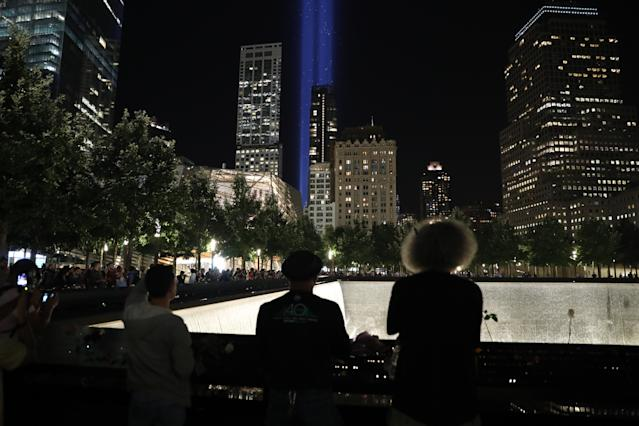<p>Visitors take photos of 'The Tribute in Light' at the National September 11 Memorial & Museum on Sept. 11, 2017. (Gordon Donovan/Yahoo News) </p>