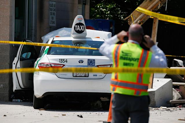 "<p>Emergency personnel work at the scene where a taxi driver struck a group of pedestrians, injuring several, Monday, July 3, 2017, in Boston. A police official said the crash is believed to be a case of ""operator error"" in which the driver stepped on the gas pedal instead of the brake. (AP Photo/Michael Dwyer) </p>"