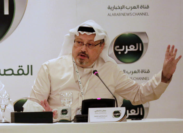 Jamal Khashoggi, then general manager of a new Arabic news channel, speaks at a press conference in Manama, Bahrain, in December 2014. (Photo: Hasan Jamali/AP)