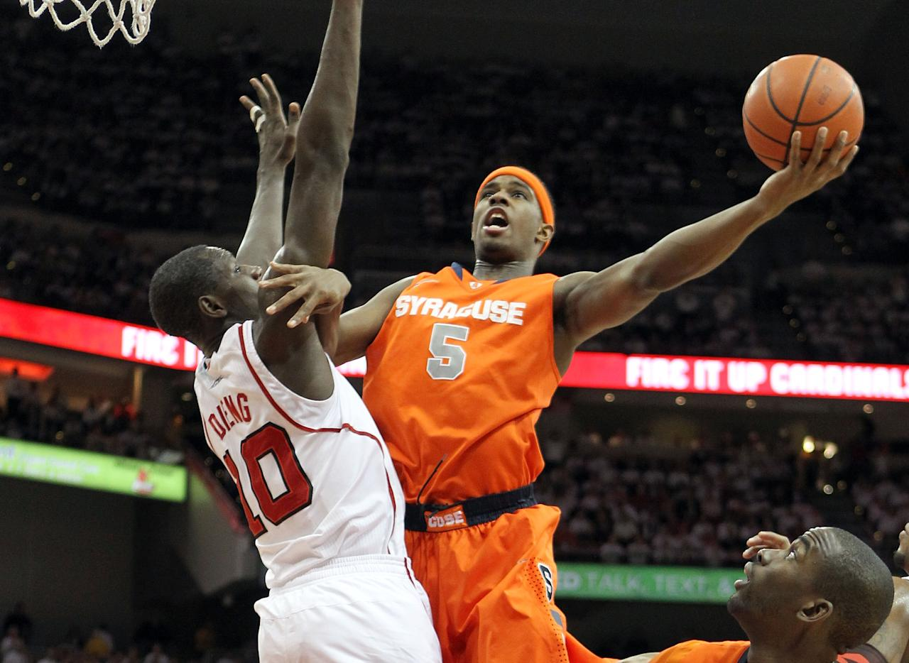 LOUISVILLE, KY - FEBRUARY 13:  C.J. Fair #5 of the Syracuse Orange shoots the ball while defended by Gorgui Dieng #10 of the Louisville Cardinals during the Big East Conference game at KFC YUM! Center on February 13, 2012 in Louisville, Kentucky.  (Photo by Andy Lyons/Getty Images)