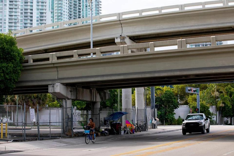 Makeshift beds and living quarters can be seen underneath the I-95 expressway off Southwest 1st street and Southwest Second Avenue in Miami, Florida, on Monday, September 20, 2021.