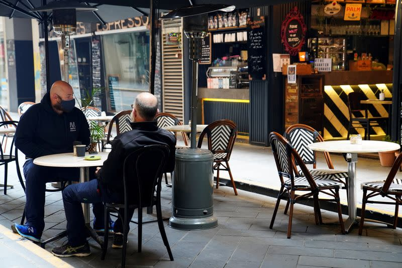 People dine at a cafe after the coronavirus disease (COVID-19) restrictions were eased for the state of Victoria, in Melbourne
