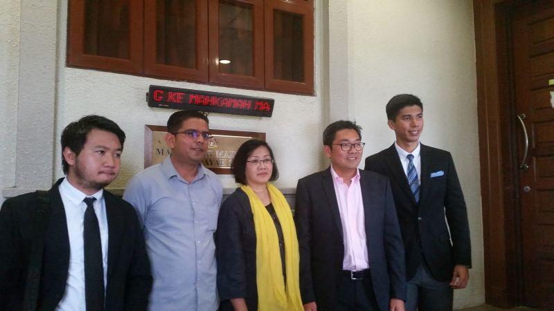 Bersih 2.0's Mandeep Singh (second from left), Maria Chin Abdullah (centre) and PKR MP Sim Tze Tzin (second from right) with their lawyers after being slapped again with a previously dropped charge of joining a 2015 'street protest'. — Picture by Ida Lim