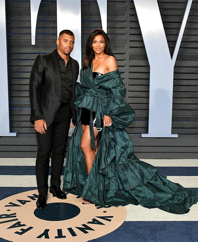 <p>The singer opted for high volume in her green Alexandre Vauthier gown, while her NFL star husband kept it simple in a black-on-black suit. (Photo: Dia Dipasupil/Getty Images) </p>