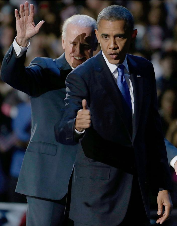 President Barack Obama flashes a thumbs up as he leaves the stage with Vice President Joe Biden at his election night party Wednesday, Nov. 7, 2012, in Chicago. President Obama defeated Republican challenger former Massachusetts Gov. Mitt Romney. (AP Photo/M. Spencer Green)