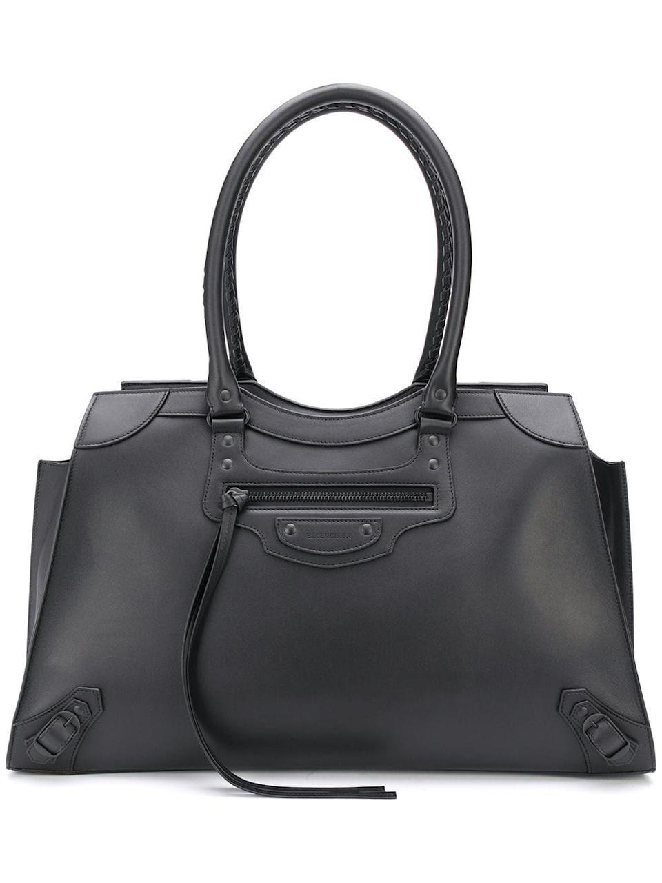 """<p><strong>Balenciaga</strong></p><p>farfetch.com</p><p><strong>$2990.00</strong></p><p><a href=""""https://go.redirectingat.com?id=74968X1596630&url=https%3A%2F%2Fwww.farfetch.com%2Fshopping%2Fwomen%2Fbalenciaga-neo-classic-large-top-handle-tote-bag-item-15659854.aspx&sref=https%3A%2F%2Fwww.harpersbazaar.com%2Ffashion%2Ftrends%2Fg22591832%2Fbest-laptop-bags-for-women%2F"""" rel=""""nofollow noopener"""" target=""""_blank"""" data-ylk=""""slk:Shop Now"""" class=""""link rapid-noclick-resp"""">Shop Now</a></p><p>This one is ideal for weekends away, too. </p>"""