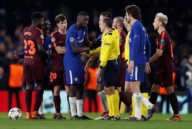 Soccer Football - Champions League Round of 16 First Leg - Chelsea vs FC Barcelona - Stamford Bridge, London, Britain - February 20, 2018 Chelsea's Antonio Rudiger speaks with referee Cuneyt Cakir after the match Action Images via Reuters/Matthew Childs