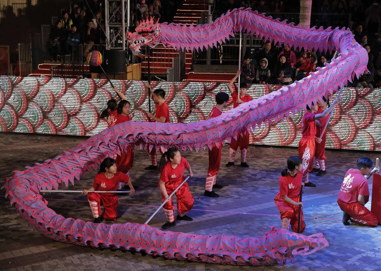 Performers show a dragon dance in a night parade to celebrate Chinese New Year in Hong Kong, Saturday, Jan. 28, 2017. The Lunar New Year this year marks the Year of the Rooster in the Chinese calendar. (AP Photo/Vincent Yu)