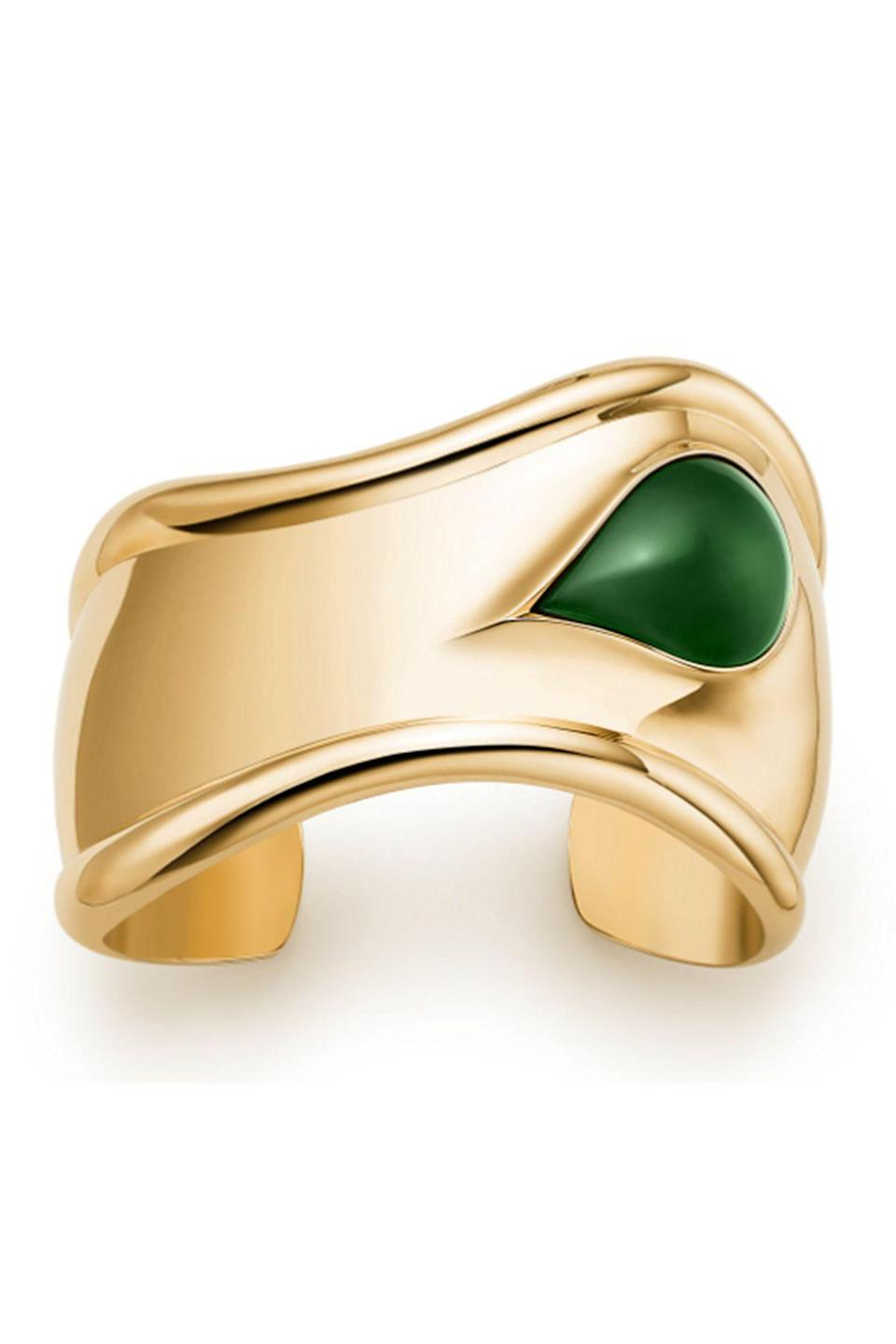"""<p><strong>Tiffany & Co.</strong></p><p>tiffany.com</p><p><strong>$18000.00</strong></p><p><a href=""""https://www.tiffany.com/jewelry/bracelets/elsa-peretti-small-bone-cuff-68282667/"""" rel=""""nofollow noopener"""" target=""""_blank"""" data-ylk=""""slk:Shop Now"""" class=""""link rapid-noclick-resp"""">Shop Now</a></p><p>Go bold with this gold and emerald bangle from Tiffany & Co. It's perfect for a formal dinner gown or a simple white t-shirt and jeans.</p>"""