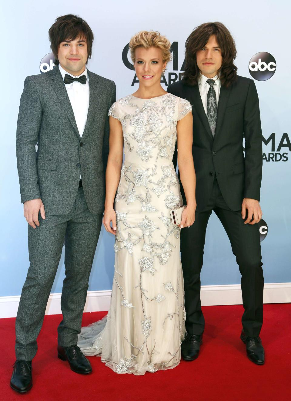 Neil Perry (L), Kimberly Perry and Reid Perry of The Band Perry poses on arrival at the 47th Country Music Association Awards in Nashville, Tennessee November 6, 2013. REUTERS/Eric Henderson (UNITED STATES - Tags: ENTERTAINMENT)