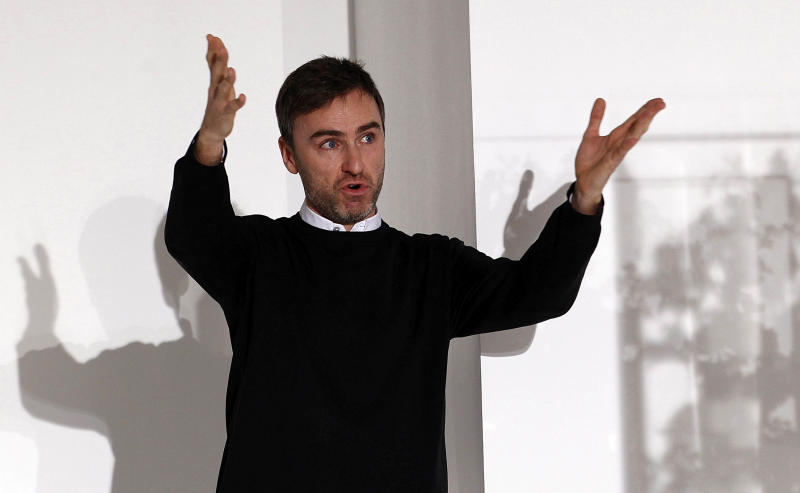 FILE -   Belgian designer Raf Simons acknowledges the applause of the audience at the end of the Jil Sander Spring/Summer 2012 women's collection in Milan, in this Saturday, Sept. 25, 2011 file photo. Christian Dior on Monday April 9 2012  named Belgian designer  Simons as its new artistic director, and says he'll present his first show for the renowned fashion house in Paris in July. The appointment comes seven months after star designer John Galliano was convicted by a Paris court for making anti-Semitic insults. (AP Photo/Giuseppe Aresu, file)