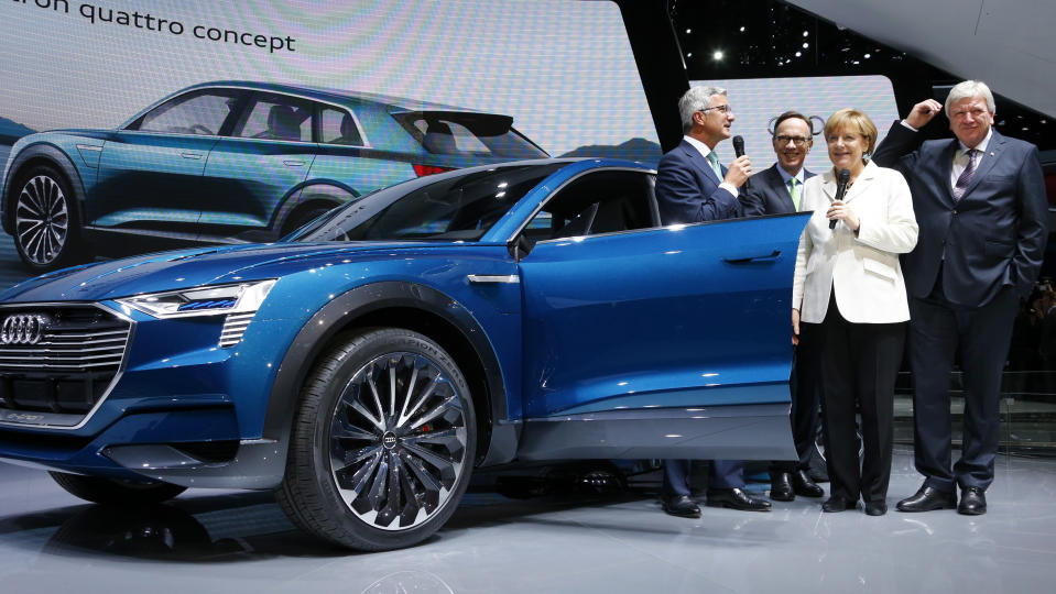 Prof. Rupert Stadler (L), Chairman of the Board of Management of Audi, Matthias Wissmann (2nd L), President of the German Automotive Industry Association (VDA), German Prime Minister of Hesse Volker Bouffier (R) and German Chancellor Angela Merkel stand next to an Audi as she makes an opening tour of the Frankfurt Motor Show (IAA) in Frankfurt, Germany September 17, 2015. REUTERS/Ralph Orlowski