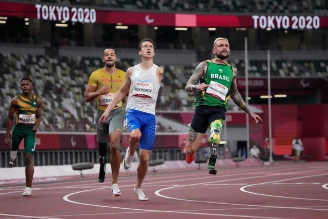 Vinicius Goncalves Rodrigues of Brazil (right) in flight before winning the men's 100m T63 final