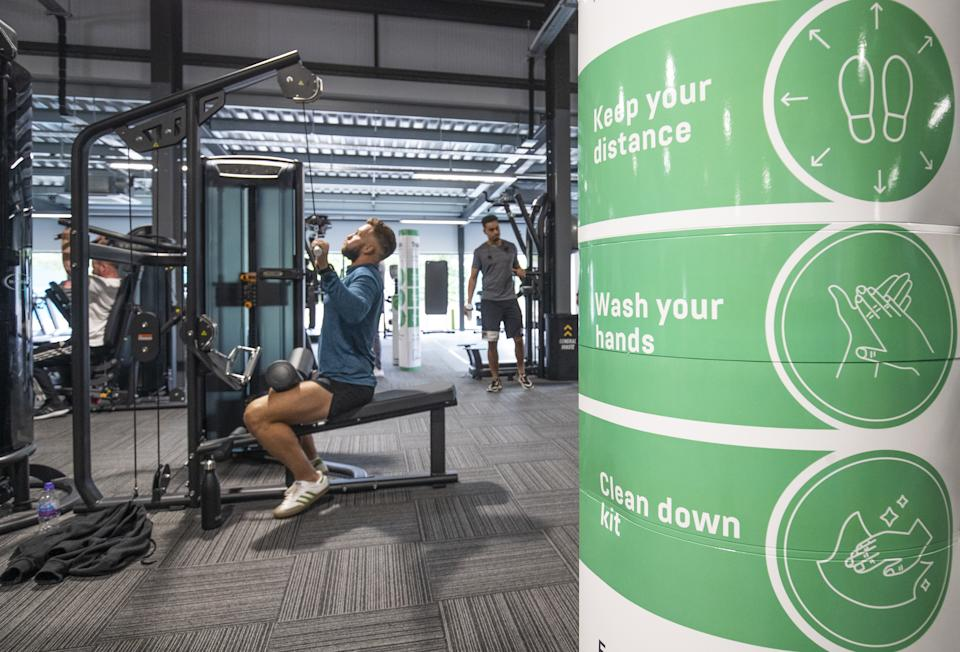 Gym members work out on socially-distanced fitness machines at the new PureGym Local in Kirkcaldy, Fife. (Photo by Jane Barlow/PA Images via Getty Images)