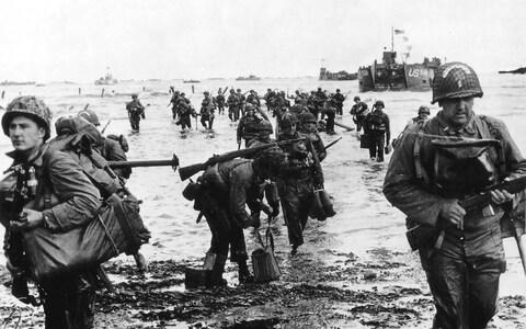 US reinforcements land on Omaha beach during the Normandy D-Day landings near Vierville sur Mer, France, on June 6, 1944 - Credit: Reuters