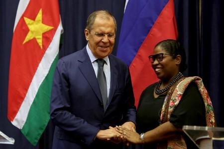 Russian Foreign Minister Sergey Lavrov poses for a photo with Suriname's Foreign Minister Yldiz Pollack-Beighle at the Foreign Affairs Ministery in Paramaribo