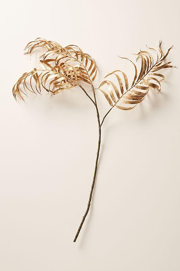 Golden palm faux foliage. (Photo: Anthropologie.com)