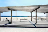 """Rockaway is back following the damage of Hurricane Sandy, and many of the most interesting developments are happening off the sand. Take the $7-each-way NYC Beach Bus from Union Square or Brooklyn, rent a surfboard, then stop for tacos at the <a href=""""http://www.rockawaybeachsurfclub.com/"""" rel=""""nofollow noopener"""" target=""""_blank"""" data-ylk=""""slk:Rockaway Beach Surf Club"""" class=""""link rapid-noclick-resp"""">Rockaway Beach Surf Club</a>, check out art at hipster gallery Topless, and have a late-night drink at the upscale crash pad <a href=""""http://www.playlandmotel.com/"""" rel=""""nofollow noopener"""" target=""""_blank"""" data-ylk=""""slk:Playland Motel."""" class=""""link rapid-noclick-resp"""">Playland Motel.</a>"""