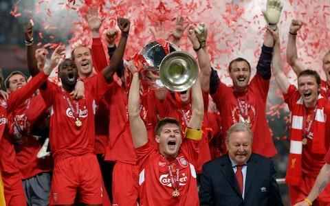 Missing out on the most iconic photograph Take a look at the most memorable image of Steven Gerrard lifting the European Cup. Behind the red ticker-tape on the podium, I should be standing to his right, but just as he went to lift the trophy I had an attack of cramp and fell on my knees. Whoever sees that photograph now sees the Spanish right-back Josemi – an unused substitute. I'm hidden from view, shouting in agony. Jamie Carragher is nowhere to be seen Credit: Getty images Getting Paolo Maldini's shirt after the game I would love to say I swapped shirts with Maldini, one of the greatest players of all time, in some grand, respectful gesture at full-time. What really happened is the AC Milan players were so upset, they slung their kits and medals and left sharpish. Our younger players – part of the travelling squad - went into the deserted dressing room, took the shirts and losers medals and handed them out. I got Maldini's shirt, and to this day some of the squad players have the losers' medals. Carragher nabbed Maldini's shirt after the game Credit: AP Spotting my family in the crowd The Ataturk Stadium holds 76,000 people, yet at the final whistle when I ran to celebrate with the supporters, who was the first person I spotted? My cousin, Jamie, was right near the front of the stand with other friends and family. The photographers again caught the moment. Talk about fate. I still struggle to put into words the sheer joy of that moment. I love that photograph. It shows what winning means, not just to the players, but to supporters and everyone who goes on that journey with us. Didi Hamann's cigar Didi Hamann arrived at Liverpool with the reputation of being one of those ultra-professional German footballers who had inflicted years of hurt on English football. European Cup final 2018 | Real Madrid vs Liverpool Remember how we perceived them? Robotic. It could not have been further from the truth. Didi was like the world's biggest Scouser at Liverpool and led the c
