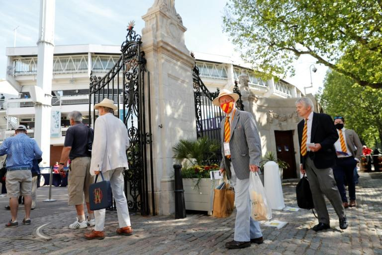 Spectators including Marylebone Cricket Club (MCC) members queue to enter Lord's Cricket Ground in London on June 2, 2021 ahead of play on the first day of the first Test between England and New Zealand