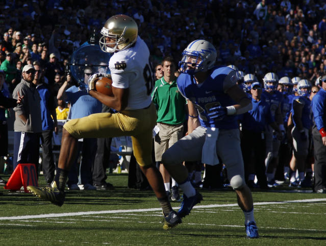 Notre Dame wide receiver Corey Robinson, left, pulls in a pass for a touchdown in front of Air Force defensive back Steffon Batts in the first quarter of an NCAA college football game in Air Force Academy, Colo., Saturday, Oct. 26, 2013. (AP Photo/David Zalubowski)