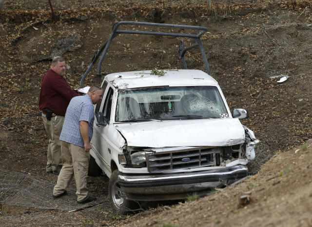 <p>Investigators view a pickup truck involved in a deadly shooting at the Rancho Tehama Reserve, near Corning, Calif., Nov. 14, 2017. (Photo: Rich Pedroncelli/AP) </p>