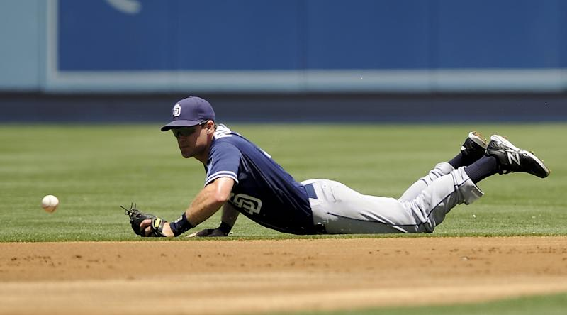 San Diego Padres second baseman Logan Forsythe cannot handle an infield grounder from Los Angeles Dodgers' Tony Gwynn, who singled, in the first inning of a baseball game, Sunday, July 15, 2012, in Los Angeles. (AP Photo/Gus Ruelas)
